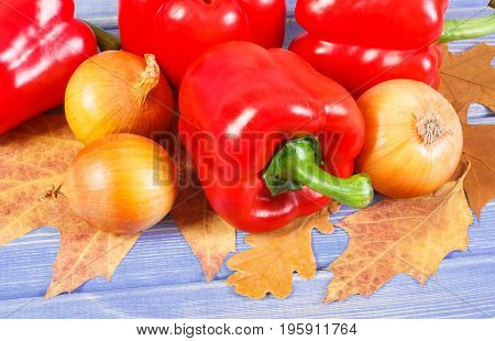 Onions And Peppers With Autumnal Leaves On Boards, Healthy Diet, Nutrition And Seasonal Concept