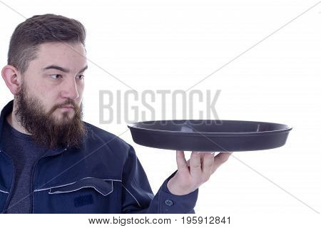 Bearded young man with a tray on a white background
