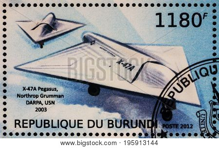 Moscow Russia - July 17 2017: A stamp printed in Burundi shows aircraft Northrop Grumman X-47A (2003) - a demonstration Unmanned Combat Aerial Vehicle series