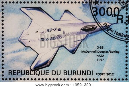 Moscow Russia - July 17 2017: A stamp printed in Burundi shows unmanned aerial vehicle McDonnell Douglas X-36 experimental tailless fighter aircraft (1997) series