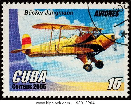 Moscow Russia - July 17 2017: A stamp printed in Cuba shows old German basic training aircraft Bucker Jungmann (1934) series