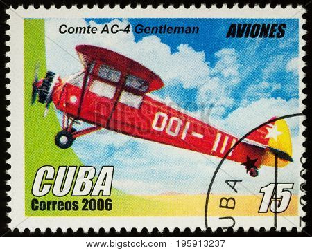 Moscow Russia - July 17 2017: A stamp printed in Cuba shows old Swiss two-seat sport and training aircraft Comte AC-4 Gentleman (1927) series
