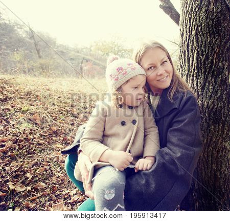 Top view portrait of cute little girl on walk in autumn park