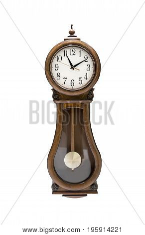 Antique wall clock with pendulum isolated on white background. Wooden vintage clock with unique design