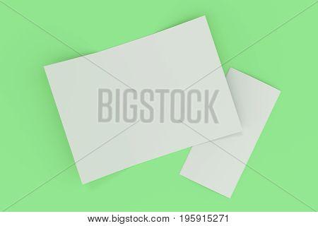 Blank White Open Three Fold Brochure Mockup On Green Background
