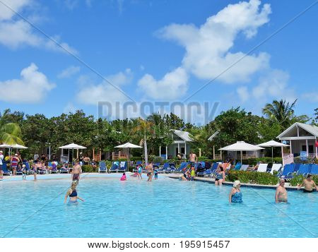 Island of Grand Turk - March 9 2017 - vacationers enjoyed the pool at the Grand Turk islands - editorial use only