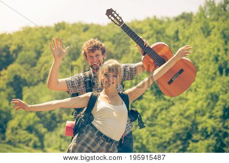 Happy Tourist Couple With Guitar Outdoor