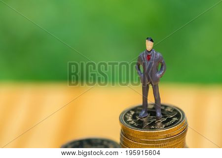Miniature People, Small Figures Businessmen Stand On Top Of Coins. Business Concept. Shallow Focus I