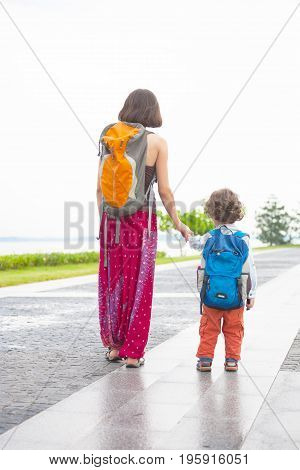 The Child Walks With His Mother.