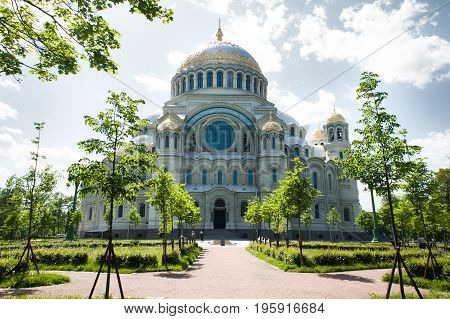 Naval cathedral of Saint Nicholas in Kronstadt, St.-Petersburg, Russia. Cathedral against the blue sky and clouds, summer, sunny day