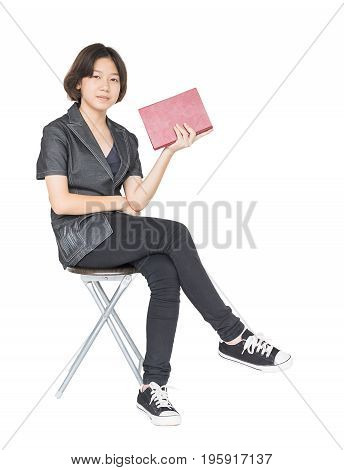 Woman Reading A Book Sitting On Chair