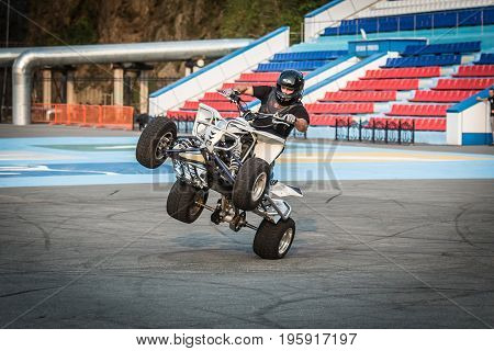 VLADIVOSTOK RUSSIA - October 05 2013: Stunt motorcycle rider performing at a local motorcycle show.