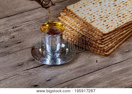Passover Matzo With Kiddush Cup Of Wine Wooden Table