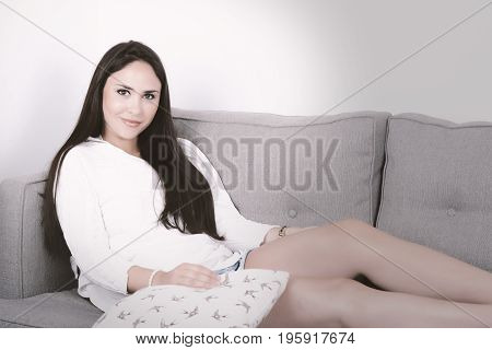 Woman Lying On Couch.
