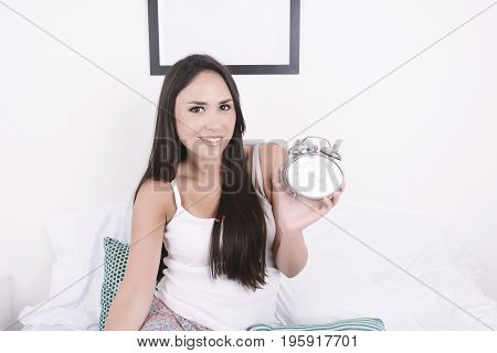 Woman With Alarm Clock.