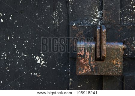 Grunge old shabby metal black crackle closed backdrop.