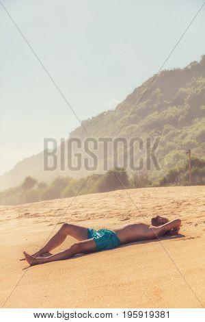 Man enjoying on empty tropical exotic beach.
