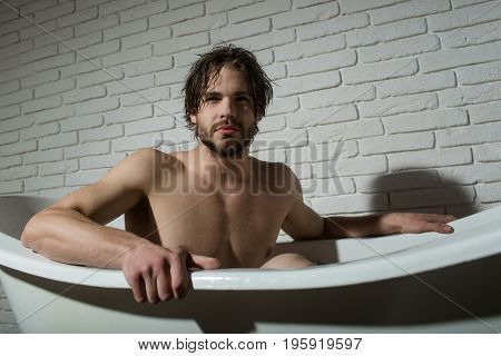 Man With Muscular Body In Bath