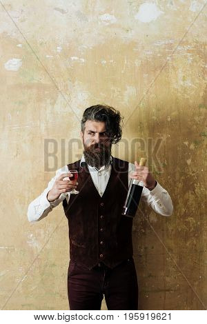 Hipster Holding Bottle And Glass Of Wine