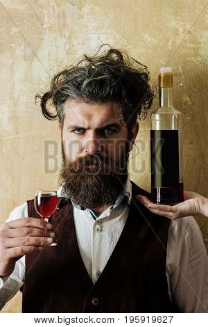 Man Posing With Wine Glass And Bottle On Female Hand