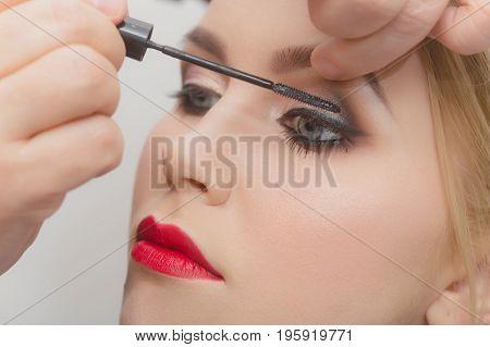 Fashion Model Girl Getting Mascara On Eyelashes