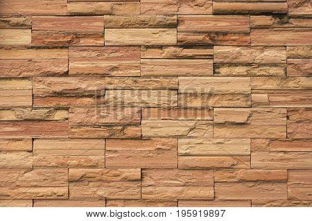Pattern of wall nade of square orange bricks