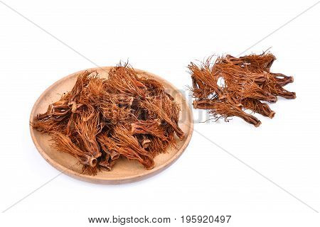 pile of dried bombax ceiba in wooden plate asia herbs isolated on white background