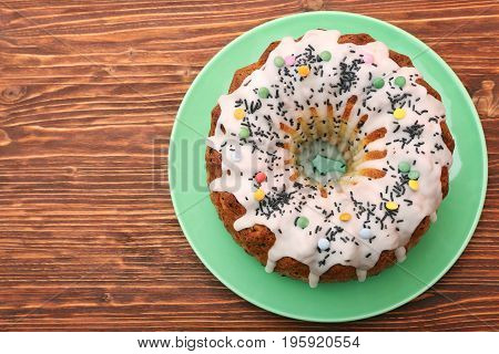 Summer Bundt Cake Topped with Sugar Glaze on wooden background