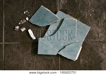 Pieces of broken tiles on the intact tiles