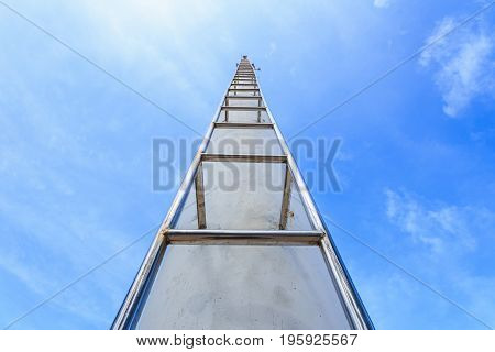 Close up high steel ladder on clear blue sky background