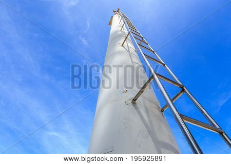 High Steel Ladder On Clear Blue Sky Background