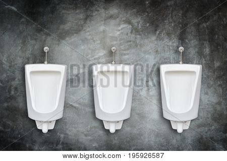 New row of ceramic outdoor urinals in men public toilet install on the wall