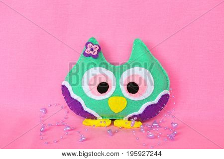 Felt owl - handmade felt colorful owl toy on pink background