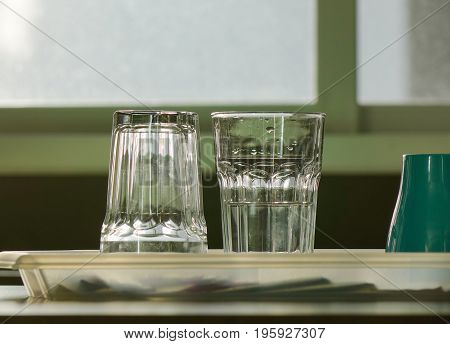 Empty Glass Cups On Table In Kitchen