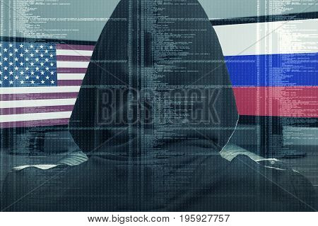 Hacker working on a cyber attack on USA and Russia. Concept of hacking into the computer.