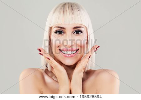 Surprise Concept. Surprised Woman Smiling. Happy Model with Makeup and Bob Hairstyle