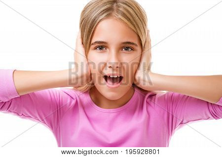 Emotions,expressions,people concept.Young girl holding hands to her head and screaming on white background