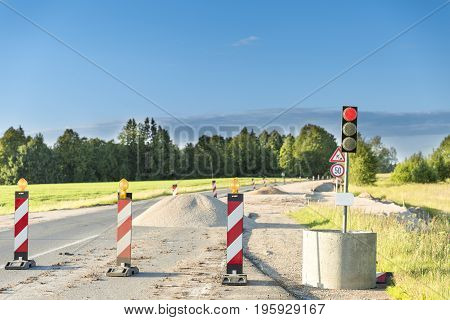 Traffic safety roadwork signs and light on highway