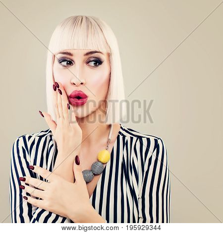 Fashion Portrait of Shocking Surprised Woman. Glamour Model with Makeup Manicure Blonde Hair