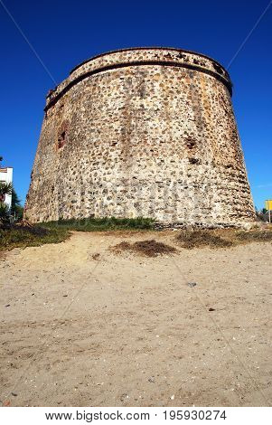 Old watchtower on Playa de las Canas beach Marbessa Marbella Malaga Province Andalusia Spain Western Europe.