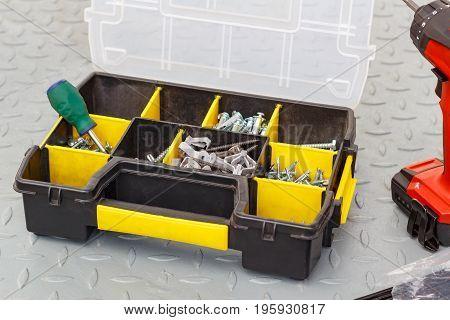 Screws In A Storage Box With Screwdriver
