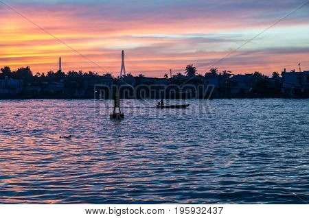 Can Tho, Vietnam - August 12, 2015: Traditional boats on the Can Tho River in Can Tho, Vietnam at sunrise.