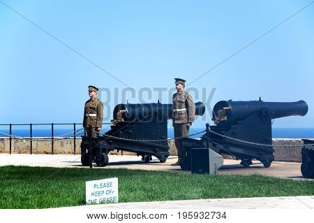 VALLETTA, MALTA - MARCH 30, 2017 - Soldiers getting ready to fire the cannons for the Noon Gun in Upper Barrakka Gardens Valletta Malta Europe, March 30, 2017.