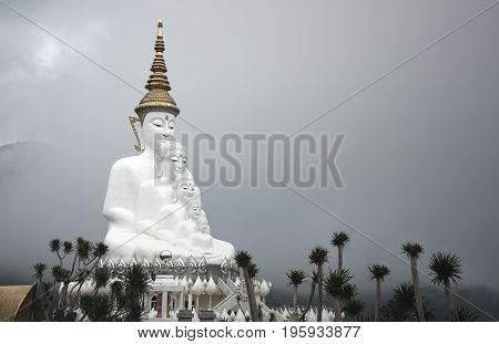 Big five white Buddha statue on cloudy sky background at Wat Phasornkaew temple Phetchabun Thailand