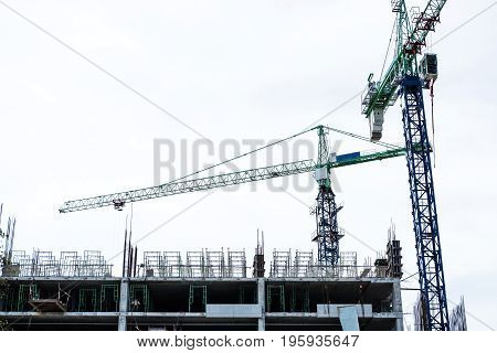 Building under construction site on white clear sky