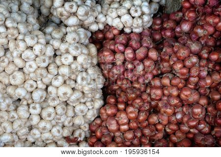 garlic and red onion for sell at local farmer's market in Thailand. ingredient cooking background