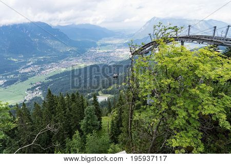 View from above on Garmisch-Partenkirchen with cable car station