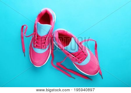 Pink Sport shoes on the blue background