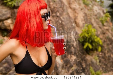 Woman With Red Hairs Drink Red Cocktail.
