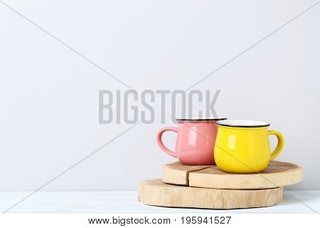 Pink And Yellow Mug On White Wooden Table